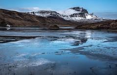 Ice in the sun. (AlbOst) Tags: lochfada oldmanofstorr skye isleofskye trotternishridge ice meltingice lochs frozenlochs reflections scotland