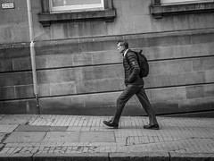 Climb (Leanne Boulton) Tags: building urban street candid streetphotography candidstreetphotography streetlife opticalillusion man male walking stride step slope hill climbing uphill angles lines perspective dutchangle tilt sandstone wall footpath composition tone texture detail naturallight outdoor light shade city scene human life living humanity society culture people canon canon5d 5dmkiii 50mm ef2470mmf28liiusm black white blackwhite bw mono blackandwhite monochrome glasgow scotland uk
