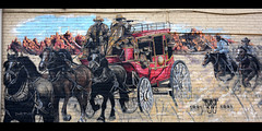 Highwaymen (Poocher7) Tags: art wallmural publicart 1881 oldwest highwaymen robbers guns stagecoach horses west westernexpress brickwall mural painting cowboys rifles redstagecoach red teamofhorses guelph ontario canada westernhotel sundaylights ponchos streetart