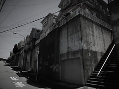(Human-Faced Bun & Honey Pudding) Tags: building wall house town scape street road sky bnw black white mono stairs steps electrical wire light pole handrail shutter hill uptown quiet residential area scene shadow