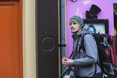 Backpacker (Frank Fullard) Tags: frankfullard fullard candid street tourist visitor dingle kerry tophat beanie colourful colorful irish ireland dublinairport backpacker portrait streetportrait