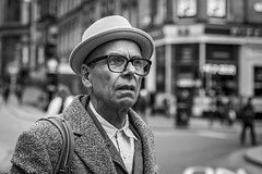 Is it a Bird? Is it a Plane? (Leanne Boulton (Away)) Tags: urban street candid portrait portraiture closeup streetphotography candidstreetphotography candidportrait streetportrait streetlife man male face eyes expression hat look emotion mood feeling style stylish fashion tone texture detail depthoffield bokeh naturallight outdoor light shade city scene human life living humanity society culture people canon canon5d 5dmkiii 70mm ef2470mmf28liiusm black white blackwhite bw mono blackandwhite monochrome glasgow scotland uk