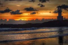 Sunset behind the lighthouse on Nangthong beach, Khao Lak,  Thailand. (niknak2016) Tags: sunsetandsea sundown thaisunset sunsetlovers goldensunset sungoingdown dusk sunsetsilhouette sunsetsky cloudsandsunset settingsun sunsetview sun sunsetphotography sunsetonthebeach sunsetcolours coloursofsunset beautyinnature naturalbeauty naturelovers nature nangthongbeach natural naturephotography wonderfulnature seascape seaandsky seafront seaside sea seaphotography horizonoversea seashore beautifulearth beautifulscenery beautifulview sandybeach beach horizon lighthouse silhouette thailand khaolak travelphotography travel vacation holiday wanderlust mothernature rocks coastline coast coastalphotography shoreline