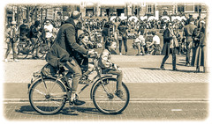 Amsterdam Rush Hour (Michael Shoop) Tags: michaelshoop amsterdam thenetherlands netherlands noordholland holland canon rijksmuseum rijksmuseumamsterdam iamsterdam bicycle bike father sons bw blackandwhite canon7dmarkii candid candidstreetphotography museumplein