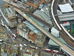 Top Of The Market (Douguerreotype) Tags: traffic london people uk market tracks british buildings train roof street architecture city britain urban bus rails gb england
