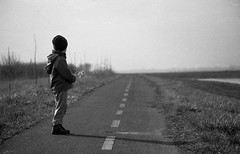 Where will it take me? (sinnedasAkmak) Tags: road path black white blackandwhite kid boy lad spring bikeroad grass contrast grey