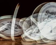 Let The Chips Fall Where They May... (Wes Iversen) Tags: circles macromondays 1 grandblanc hmm macro macros michigan soaringeaglecasinoresort tokina100mmf28atxprod chips falling longexposure tables spinning