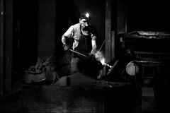 Le travailleur des ténèbres / The worker in the darkness (vedebe) Tags: homme humain human people usine travail noiretblanc netb nb bw monochrome urbain urban urbanarte lumière
