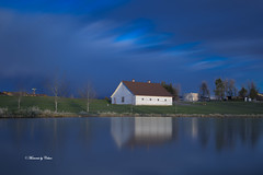 Smooth reflections (Canon Queen Rocks (2,090,000 + views)) Tags: water reflections elkgrove momentsbycelinecom montana usa bluesky blues lee filters sky barn silo trees pond landscape scenery scene building grass light tree structure landschaft
