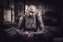 """Nothing personal, it's just business"" (DugieUK) Tags: mal man beard bald tattoo tattoos vest cross faith intimidating hard enforcer hardman decay abandoned derelict dark shadow light dugie alan duggan"