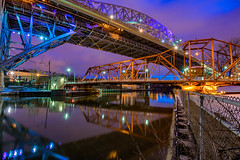 Over Under (tquist24) Tags: cleveland cuyahogariver hdr nikon nikond5300 ohio outdoor theflats veterensmemorialbridge architecture bluehour bridge city cityscape clouds color drawbridge evening fence geotagged lights longexposure reflection reflections river sky water unitedstates