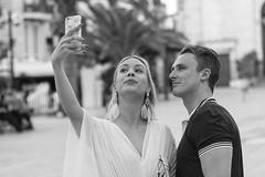 Taking the selfie takers! (Frank Fullard) Tags: frankfullard fullard candid street couple photographer selfie beautiful portrait monochrome pretty blackandwhite happy blanc noir blonde earrings