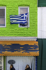 Greektown - Baltimore, Maryland (crabsandbeer (Kevin Moore)) Tags: event baltimore flag greek independenceday parade people greektown highlandtown maryland greece facade color colorful pattern geometry formstone painted windows wind greekparade urban city street streetphotography