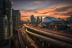 Baseball's Back! (Paul Flynn (Toronto)) Tags: sunset toronto rogers centre blue jays baseball gardiner expressway highway road street long exposure clouds sky stadium sports towers downtown skydome