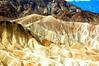 A Seldom Photographed Angle of Zabrieski Point (EmperorNorton47) Tags: deathvalleynationalpark california photo digital spring zabrieskipoint desert erosion mountains hills badlands nps nationalpark worldheritagesite goldencanyon unesco landscape