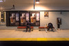 I Could Use a Beer (cookedphotos) Tags: 2018inpictures toronto ontario canada ca canon 5dmarkiv streetphotography ttc subway station platform wellesley sitting hunched tired beer advertisement drink 365project p3652018 crutches leg injured