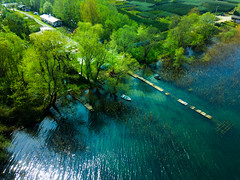 Over the Lake (mucahits) Tags: drone fly fromabove droneshot mavic mavicpro lake forest green blue water reeds oldpier pier dock flight