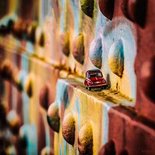 red fiat 500 on colorful old bridge
