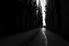 Follow My Trail (elgunto) Tags: street people blackwhite bw x100s fujifilm fujix streetphoto barcelona silhouette monochrome highcontrast track lines perspective