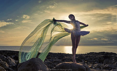 Delicate Dancer (modulationmike) Tags: ballet sunset nikon beach coastal tutu legs chiffon offcameraflash colour beauty lighting sunlit backlit pose pointe skies clouds bright shadows lowangle dancer rocks reflections