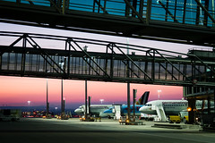 sunrise at the airport (Al Fed) Tags: 20180411 airport italy milano morning stuttgart sunrise germanwings machines planes aircrafts gangway