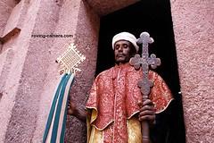 Priest Holding Crosses in Lalibela, Ethiopia (deemixx) Tags: ethiopia africa lalibela priest cross christian christianity ethiopianorthodoxchurch