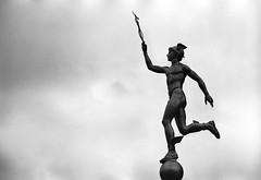 «Hermes» (Mercury) in the Dmitrov City (nonnull) Tags: dmitrov moscowregion russia dmitrovskydistrict filmphotography filmphoto filmisnotdead filmtype135 film analogphotography blackandwhite noiretblanc bnwmood bnwfilm bnw bw bwfp artinbw ru sculpture art citywalks monochrome monotone silberrapan50bwpanchromaticfilm silberrapan50 silberra pentaxspotmaticii pentax jupiter9 barhatovcom d76 noir grain dark россия московскаяобласть дмитровскийрайон дмитров городскиезаметки город фотопленка пленка чб чернобелое скульптура чбфото cloud clouds sky nikonsupercoolscan4000ed 2018 m42