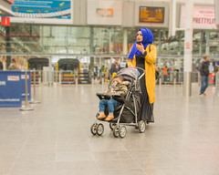 Piccadilly Station Manchester (tramsteer) Tags: tramsteer piccadilly station child muslim buggy manchester mother trains pram phone headscarf
