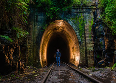 Self portrait in tunnel (daniel.pertovt) Tags: 500px eyeem shutterstock strobist viewbug abandoned dark flash glowworm jungle overgrown plants portrait railway ruin selfportrait spooky tunnel
