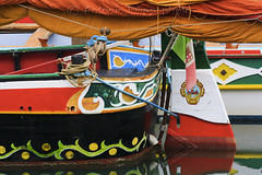 A very colorful boat (filippi antonio) Tags: art artistic beautiful boat color colorful culture detail family flag fun funny harbor harbour holiday italy italycolors italyflag landmark national nationalflag old people place port scenic sea shore show street summer symbol symbols tourism touristic tradition traditional travel vacation voyage wood canon caorle venezia veneto