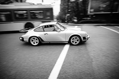 911 on Cambie Street (Eric Flexyourhead) Tags: vancouver canada britishcolumbia bc downtown cambiestreet penderstreet city urban street streetscape streetscene car german porsche 911 930 turbo porsche911 porsche911turbo porsche930 porsche930turbo ruf panning movement motion blur vignette monochrome blackwhite bw sonyalphaa7 voigtlandercolorskopar21mmf4 voigtlander 21mmf4 vancouvercars carsofvancouver