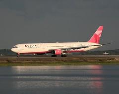 Delta          Boeing 767                     N845MH (Flame1958) Tags: delta deltaairlines deltab767 deltalogojet boeing767 boeing b767 767 b7674 b767400 bos kbos bostonairport loganairport dusk bostonloganairport forceforglobalgood globalgood pinkjet evelynlauder n845mh 0627