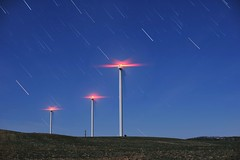 Wind Farm (Kirby Wright) Tags: star stars trails night sky full moon wind turbines poles light long exposure middleton wisconsin motion rotation nikon d700 50mm 12 f12 red white blue spring field nature outdoors all alone