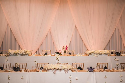"Head Table with Peach Backdrop and Gold Chiavari Chairs • <a style=""font-size:0.8em;"" href=""http://www.flickr.com/photos/81396050@N06/41379481765/"" target=""_blank"">View on Flickr</a>"