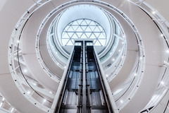 The LSE (Rich Walker75) Tags: london architecture spiral ramp staircase lift lifts elevator atrium skylight white abstract england photography canon efs1585mmisusm eos eos80d