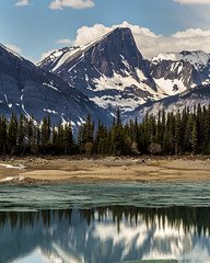 Lower Kananaskis Mount Sarrail (Terry L Richmond) Tags: snow mountain nature lake water landscape reflection glacier ice wilderness sky mountainrange tree river outdoor scenic mountainouslandforms noperson pond outdoors man mountainpeak travel peak sitting conifer mountscenery standing flora highland flock plant rocky wood herd front scenery cloud large grass alpine winter surrounded bank sheep valley fell cattle kananaskis alberta