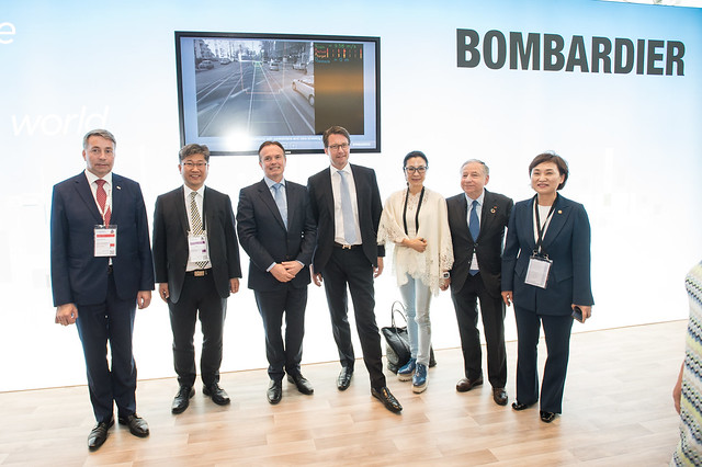 Uldis Augulis, Young Tae Kim, Laurent Troger, Andreas Scheuer, Michelle Yeoh, Jean Todt and Hyun-mee Kim at the Bombardier stand