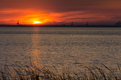 Sunset 2 (sugarhouse2) Tags: mobile bay alabama water dock docks sunset red glow clouds waves grass evening set sun sky