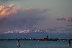 When mountains crumble into the sea (U1D2X) Tags: montagne neve snow mountain sea water lagoon venezia venice italy dolomiti winter spring easter alberoni laguna veneta san marco campanile panorama tramonto