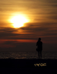 """The sun is alone too, but still it shines."" (A. K. Hombre) Tags: sunset silhouette sanjuanlaunion beach water sea sky ciel himmel sundown clouds sand"