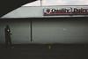 DriveBy 2488: QD (Dimi Sahn) Tags: street man sign road store building