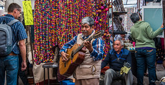 2018 - Mexico City - Bazar del Sabado (Ted's photos - For Me & You) Tags: 2018 cdmx cityofmexico cropped mexicocity nikon nikond750 nikonfx tedmcgrath tedsphotos tedsphotosmexico vignetting bazardelsabado sanangelbazardelsabado bazardelsabadosanangel saturdaymarket sanangelsaturdaybazaar saturdaybazaarsanangel musician backpack guitar guitarplayer denim denimjeans 6stringguitar seat stool colorful colourful vest teeth dents artist plazatenanitla sanangelplazatenanitla plazatenanitlasanangel beard moustache greyhair zipper strumming