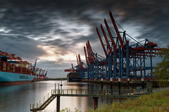 Before Sunset (T.Seifer : )) Tags: habour moored marina pier terminal ship quayside waterfront evening sundown sunlight sunset water longexposure travel fx germany reflection clouds nikon sky river elbe light hamburg outdoors europe port waltershof outside