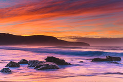 Vibrant Rocky Sunrise Seascape (Merrillie) Tags: daybreak sunrise cloudy australia nsw centralcoast clouds sea newsouthwales rocks earlymorning morning water landscape ocean nature sky waterscape coastal seascape outdoors killcarebeach dawn coast killcare waves