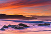 Vibrant Rocky Sunrise Seascape (Merrillie) Tags: daybreak sunrise cloudy australia nsw centralcoast clouds sea newsouthwales rocks earlymorning morning water landscape ocean nature sky waterscape coastal seascape outdoors killcarebeach dawn coast killcare waves