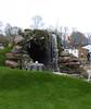 Hobbity Showpiece (vw4y) Tags: hobbithouse bilbobaggins thehobbit waterfall greengrass mugs fantasyland rhs cardiff giantflowers yarnbomb