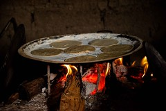 Cooking Tortillas (Rod Waddington) Tags: mexico chiapas san christobal cooking tortillas fire wood home food indoor pan