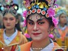 2018-02a Bangkok Chinatown (58) (Matt Hahnewald) Tags: matthahnewaldphotography facingtheworld live aesthetic springfestival chinesenewyear parade performer dancer makeup lunaryear festival head face painted eyes costume consent fun entertainment travel tourism culture tradition enjoyment socialevent diversity impact traditional cultural folklore touristattraction celebration historical yaowarat bangkok chinatown thailand thaichinese asia image photo faceperception physiognomy nikond3100 primelens 50mm 4x3 horizontal street portrait closeup outdoor color colorful posingforcamera iconic awesome incredible authentic sightseeing partying photography ambiguity attire headgear softfocus character relationship tripleportrait smallgroup headshot lookingatcamera