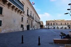 Malta Streets (Douguerreotype) Tags: people city street buildings flag malta architecture valletta urban
