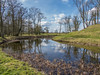 Moated Landscape (Ian M Bentley) Tags: lyvedennewbield lyveden northamptonshire march 2018 nationaltrust unfinished incomplete england olympus omd em1ii tamron14150mm megazoom wideangle landscape gradeilistedbuilding enigmatic eastnorthampton elizabethan 1605 tresham moat pyramidmounds fishpond footbridge outdoor sky cloud water reflection countryhouse manor trees wood reeds grass